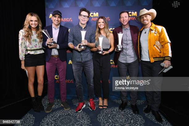 Carly Pearce and Dustin Lynch pose with Eddie Garcia Bobby Bones Amy Brown and Dan Chappell aka Lunchbox of The Bobby Bones Show recipients of the...