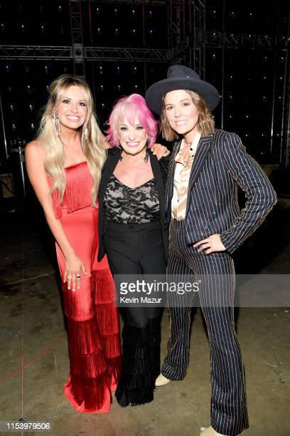 Carly Pearce Tanya Tucker and Brandi Carlile attend the 2019 CMT Music Awards Backstage Audience at Bridgestone Arena on June 05 2019 in Nashville...