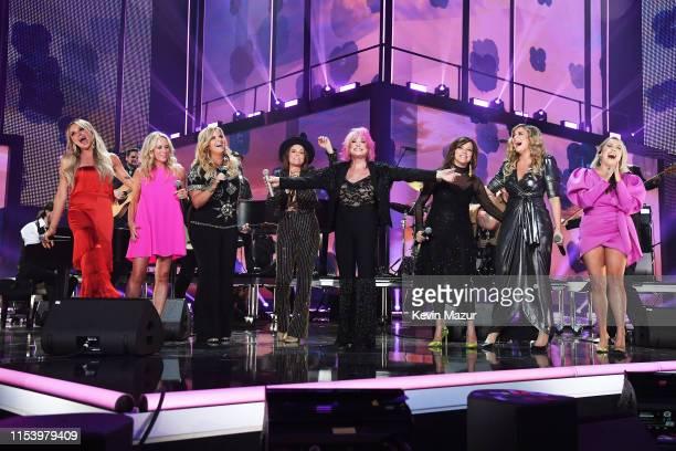 Carly Pearce Trisha Yearwood Brandi Carlile Tanya Tucker Martina McBride Lauren Alaina and RaeLynn perform at the 2019 CMT Music Awards at...