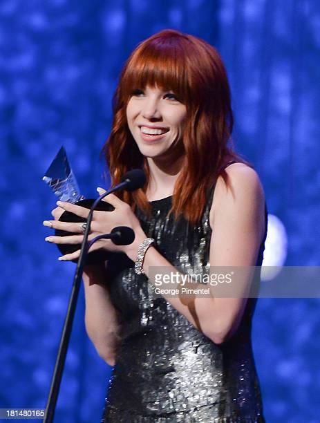 Carly Rae Jepsen accepts the 2013 Allan Slaight Award at Canada's Walk Of Fame Ceremony at The Elgin on September 21 2013 in Toronto Canada