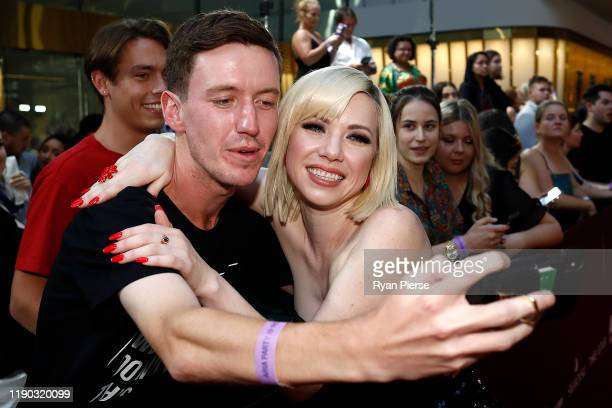 Carly Rae Jepsen poses with a fan on the red carpet ahead of the 33rd Annual ARIA Awards 2019 at The Star on November 27 2019 in Sydney Australia