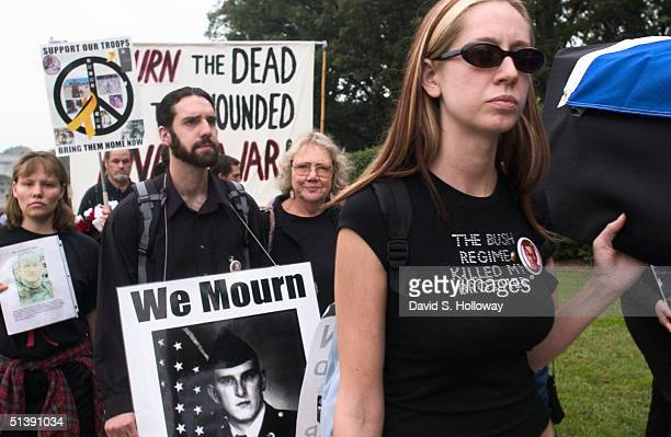 WASHINGTON OCTOBER 2 Carly Sheehan right of Vacaville CA carries a fake coffin during a memorial procession in Washington DC on October 2 2004...