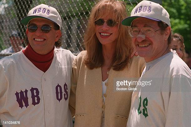 Carly Simon center Alan Dershowitz right and an unidentified man at the WBOS celebrity series baseball game on Boston Common May 20 1995
