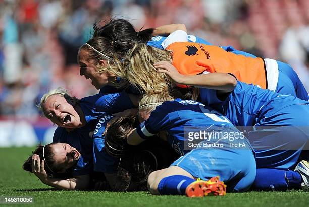 Carly Telford of Birmingham City Ladies FC is mobbed by her team mates after Gemma Bonner of Chelsea Ladies FC misses her penalty during the FA...