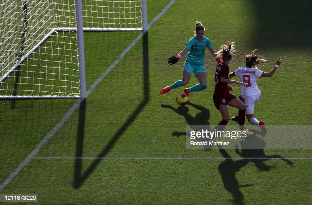 Carly Telford of England plays the ball in front of Marta Cardona of Spain and Abbie McManus in the second half of the 2020 SheBelieves Cup at Toyota...