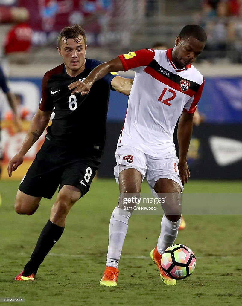 Carlyle Mitchell #12 of Trinidad & Tobago is defended against by Jordan Morris #8 of the United States during the FIFA 2018 World Cup Qualifier at EverBank Field on September 6, 2016 in Jacksonville, Florida.