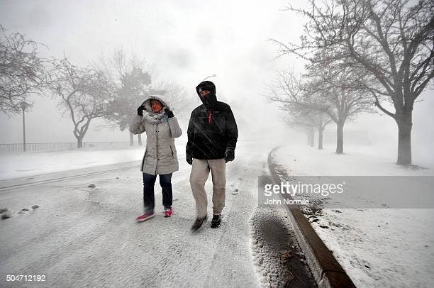 Carm Nardilillo and Dan Morris walk along the shore of Lake Erie in Buffalo New York January 12 2016 The Buffalo and Western New York area is bracing...