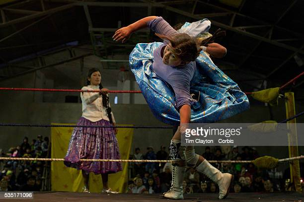 Carman Rosa is thrown by her male counterpart as her tag team mate Yolanda La Amorosa looks on during the 'Titans of the Ring' wrestling group's...