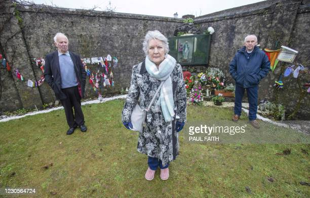 Carmel Larkin , Walter Francis , and PJ Harvey, all survivors, of the Bon Secours Mother and Baby Home, pose at a shrine in Tuam, County Galway in...