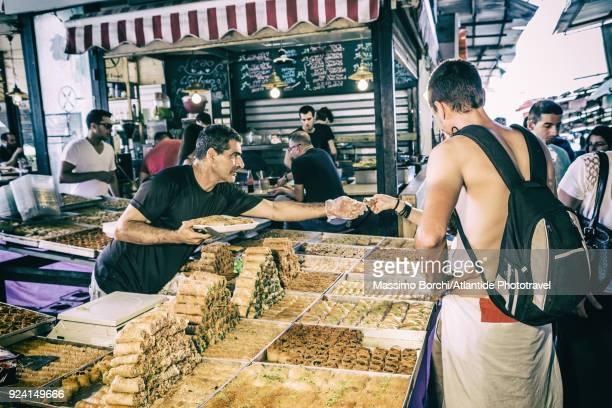 carmel market, sweet seller - tel aviv stock pictures, royalty-free photos & images