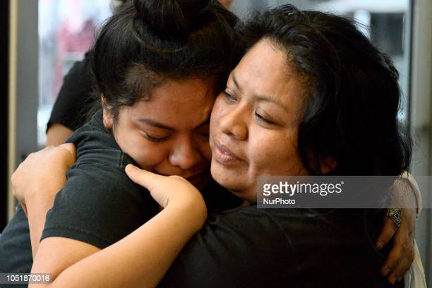 Carmela Apolonio Hernandez and daughter Keyri Artillero Apolonio embrace after receiving a warning to disperse as a group of protestors block the...