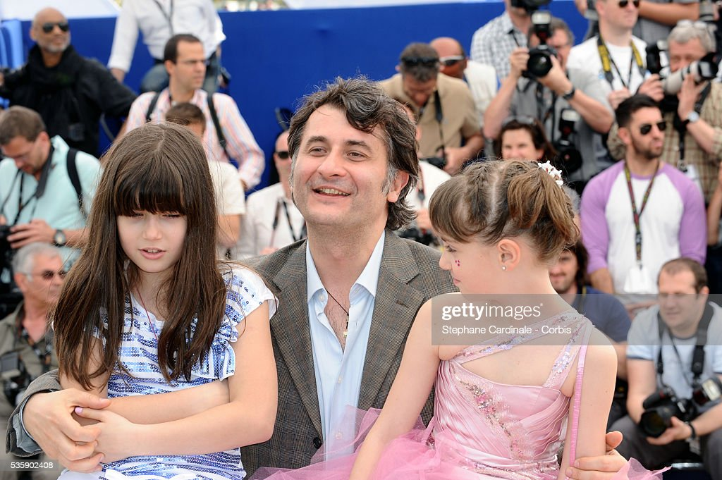 Carmela Culda, Cristi Puiu and Ileana Puiu at the photocall for 'Aurora' during the 63rd Cannes International Film Festival.