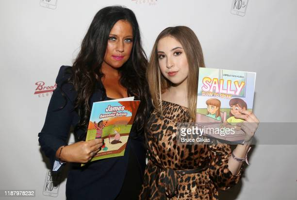 Carmela Florio and Carrie Berk pose during a launch event promoting Selfie Kid X Brooklyn Cloth Limited Edition TShirt Collaboration at Planet...