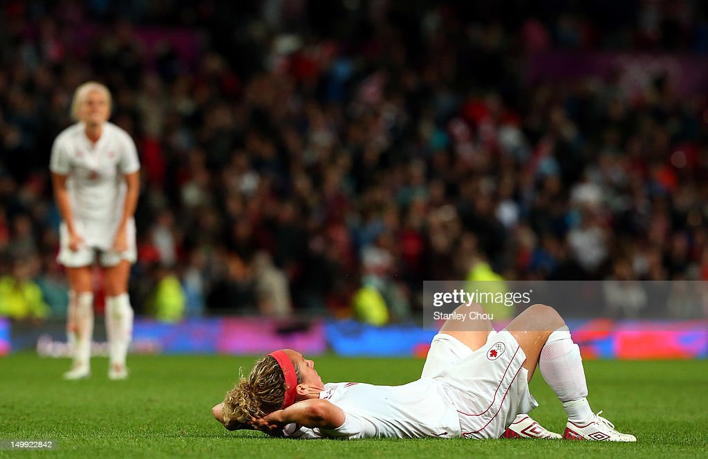 Carmelina Moscato of Canada lies in dejection after her team was defeated to the United States 4-3 during extra time during the Women's Football Semi Final match between Canada and USA, on Day 10 of the London 2012 Olympic Games at Old Trafford on August 6, 2012 in Manchester, England.