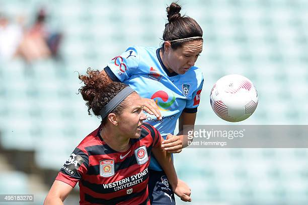 Carmelina Moscato of the Wanderers and Kyah Simon of Sydney FC contest the ball during the round three WLeague match between the Western Sydney...