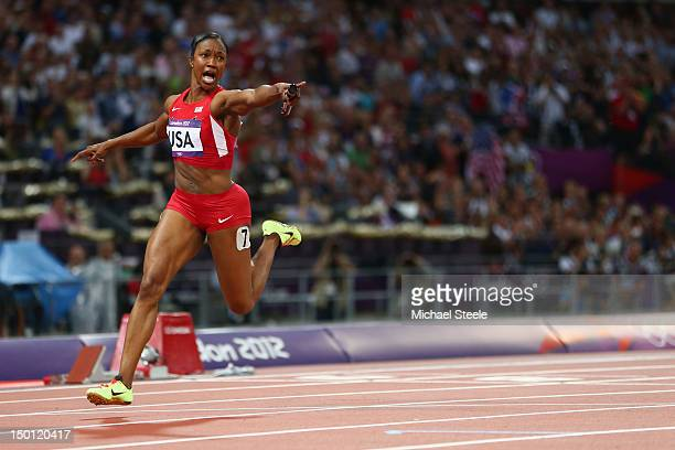 Carmelita Jeter of the United States celebrates winning gold in the Women's 4 x 100m Relay Final on Day 14 of the London 2012 Olympic Games at...