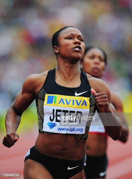 Carmelita Jeter of the United States of America crosses the finishing line to win the Womens 100m Final during the Aviva London Grand Prix at Crystal...