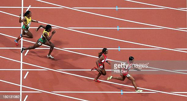 Carmelita Jeter of the United States on her way to winning gold in the Women's 4 x 100m Relay Final on Day 14 of the London 2012 Olympic Games at...