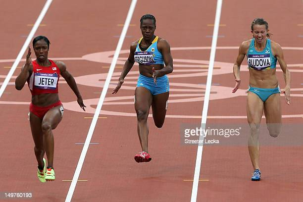 Carmelita Jeter of the United States Sheniqua Ferguson of the Bahamas and Olga Bludova of Kazakhstan compete in the Women's 100m Round 1 Heats on Day...