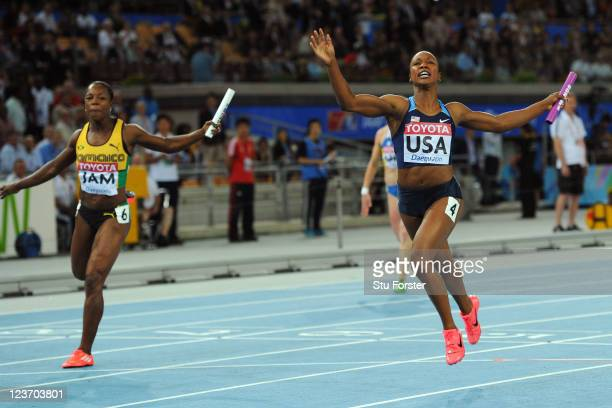 Carmelita Jeter of the USA crosses the finish line to claim victory ahead of Veronica Campbell-Brown of Jamaica in the women's 4x100 metres final...