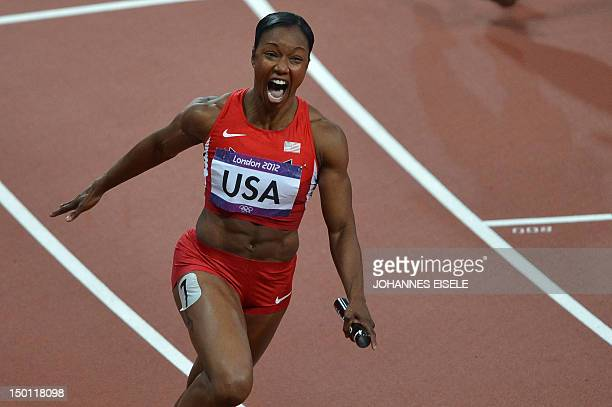US' Carmelita Jeter reacts as she crosses the finish line and clocks a new world record in the women's 4 x 100m relay final at the athletics event of...