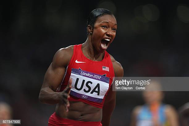 Carmelita Jeter, USA, shows her delight as she brings home the USA Women's 4 x 100 relay team of Tianna Madison, Allyson Felix, Bianca Knight and...