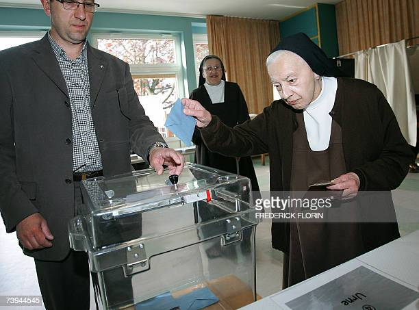 Carmelite nun of Marienthal's abbey casts her ballot at a polling station in Marienthal, eastern France, 22 April 2007. Some 44.5 million eligible...