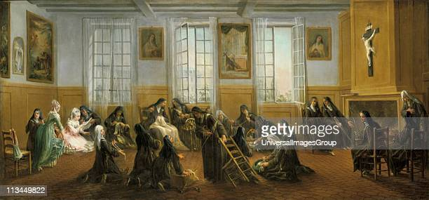 Carmelite nuns at St Denis, 18th century. Some sit in front of the fire, while others spin and sew. On kneeling centre right is making pillow lace....