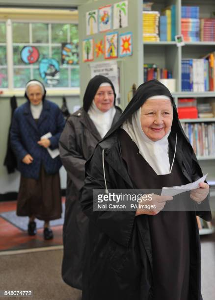 Carmelite nuns cast their votes in the European Fiscal Treaty Referendum at a polling station in north Dublin, Ireland.