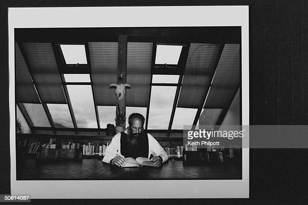 Carmelite subprior Father David Levin, reading at table in library at the Spiritual Life Institute, a monastery for 11 monks whose solitude is now...