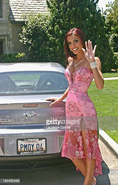 Carmella De Cesare with her new Mazda RX8 during Playboy's 2004 Playmate of the Year Carmella De Cesare at Playboy Mansion in Bel Air California...