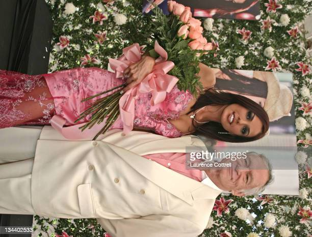 Carmella De Cesare with Hugh Hefner during Playboy's 2004 Playmate of the Year Carmella De Cesare at Playboy Mansion in Bel Air California United...