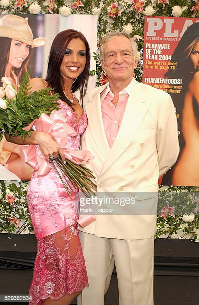 Carmella DeCesare poses with Playboy founder Hugh Hefner after being named Playmate of the Year 2004 at the Playboy Mansion DeCesare of Cleveland won...