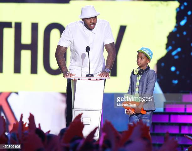 Carmello Anthony and son Kiyan Anthony speak onstage during the Nickelodeon Kids' Choice Sports Awards 2014 held at Pauley Pavilion on July 17 2014...