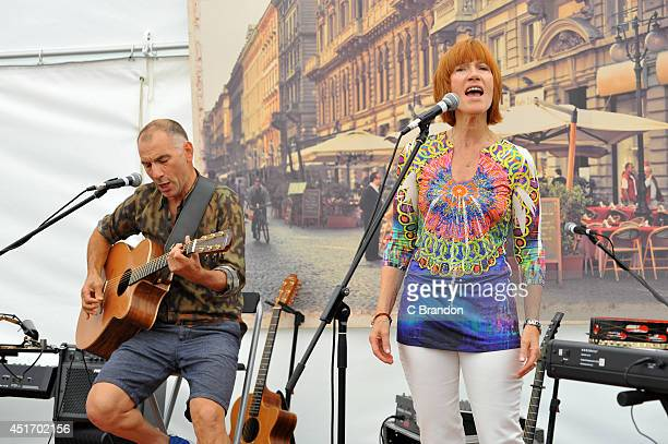 Carmelo and Kiki Dee perform on stage at the Cornbury Music Festival at Great Tew Estate on July 4 2014 in Oxford United Kingdom