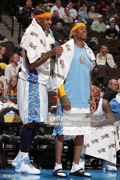 Carmelo Anthony and Allen Iverson of the Denver Nuggets cheer on their teammates from the bench during the game against the Milwaukee Bucks at the...