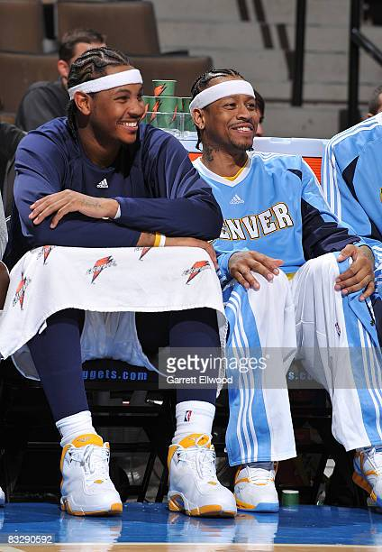 Carmelo Anthony and Allen Iverson of the Denver Nuggets share a laugh against the Utah Jazz on October 15 2008 at the Pepsi Center in Denver Colorado...