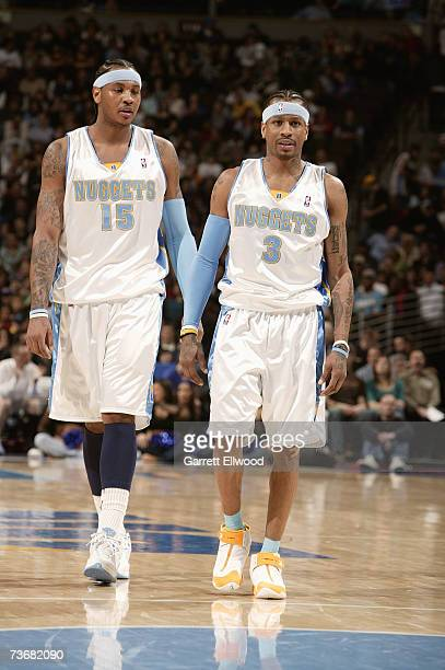 Carmelo Anthony and Allen Iverson of the Denver Nuggets walk through center court during a break in game action against the Detroit Pistons on March...