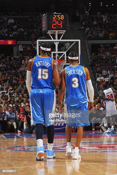 Carmelo Anthony and Allen Iverson of the Denver Nuggets walk upcourt during the game against the Detroit Pistons at the Palace of Auburn Hills on...