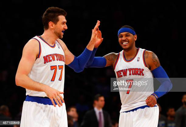Carmelo Anthony and Andrea Bargnani of the New York Knicks in action against the Orlando Magic at Madison Square Garden on December 6 2013 in New...