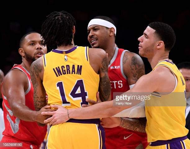 Carmelo Anthony and Eric Gordon of the Houston Rockets restrain Brandon Ingram of the Los Angeles Lakers with the help of Lonzo Ball during a 124-115...