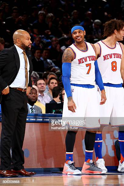 Carmelo Anthony and head coach Derek Fisher of the New York Knicks during the game on January 22 2016 at Madison Square Garden in New York New York...
