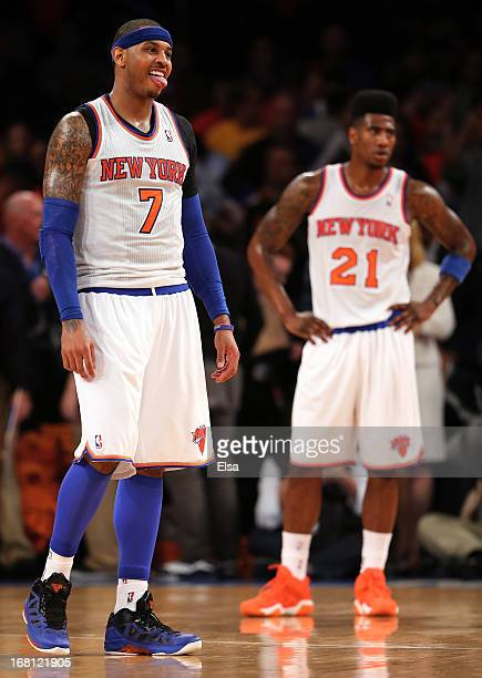 Carmelo Anthony and Iman Shumpert of the New York Knicks react as the game ends against the Indiana Pacers during Game One of the Eastern Conference...