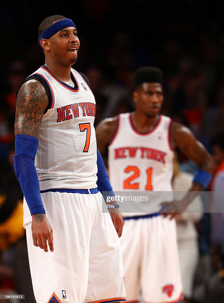Carmelo Anthony #7 and Iman Shumpert #21 of the New York Knicks react as the game ends against the Indiana Pacers during Game One of the Eastern Conference Semifinals of the 2013 NBA Playoffs on May 5, 2013 at Madison Square Garden in New York City. The Indiana Pacers defeated the New York Knicks 102-95.