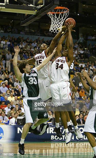 Carmelo Anthony and Jeremy McNeil of the Syracuse Orangemen battle Mike Konovelchick of the Manhattan Jaspers during the first round of the NCAA...