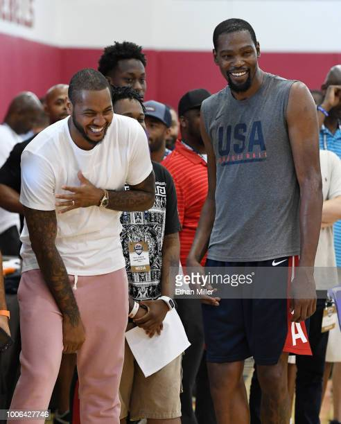 Carmelo Anthony and Kevin Durant of the United States laugh as they attend a practice session at the 2018 USA Basketball Men's National Team minicamp...