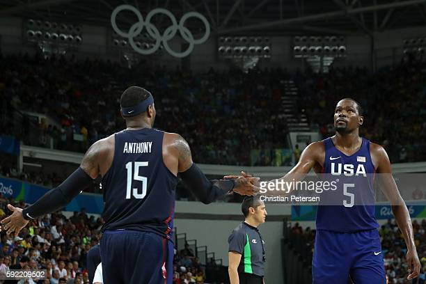 Carmelo Anthony and Kevin Durant of United States celebrate a play against Spain during the Men's Semifinal match on Day 14 of the Rio 2016 Olympic...