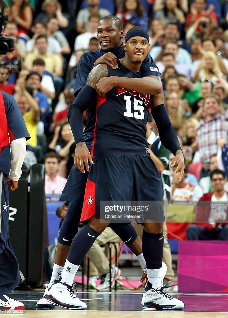 Carmelo Anthony #15 and Kevin Durant #5 of United States react while taking on Argentina during the Men's Basketball semifinal match on Day 14 of the London 2012 Olympic Games at the North Greenwich Arena on August 10, 2012 in London, England.