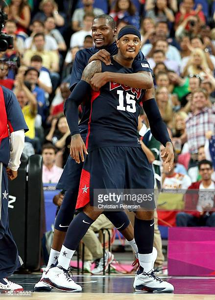 Carmelo Anthony and Kevin Durant of United States react while taking on Argentina during the Men's Basketball semifinal match on Day 14 of the London...