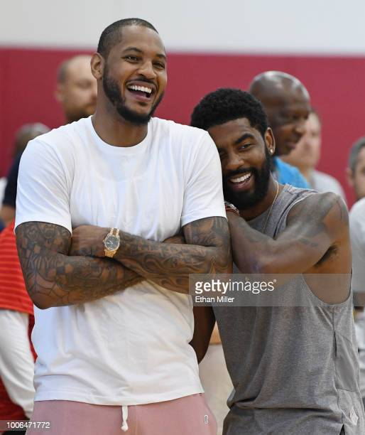 Carmelo Anthony and Kyrie Irving of the United States laugh as they attend a practice session at the 2018 USA Basketball Men's National Team minicamp...